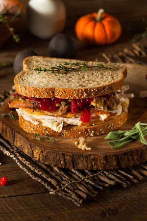 overs: Homemade Leftover Thanksgiving Sandwich with Turkey Cranberries and Stuffing Stock Photo