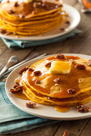 sugar maple: Homemade Pumpkin Pancakes with Butter Pecans and Maple Syrup Stock Photo