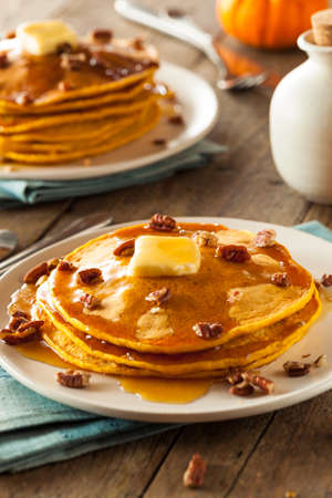 pecan: Homemade Pumpkin Pancakes with Butter Pecans and Maple Syrup Stock Photo