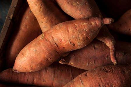 sweet background: Raw Organic Sweet Potatoes in a Box