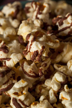 popcorn kernel: Homemade Chocolate Drizzled Caramel Popcorn Ready to Eat