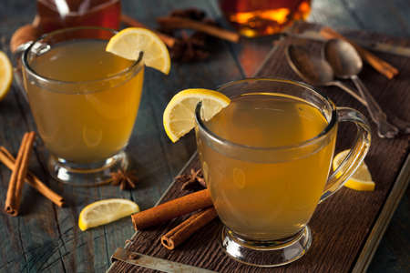 Warm Hot Toddy with Lemon Bourbon and Spices Stock Photo