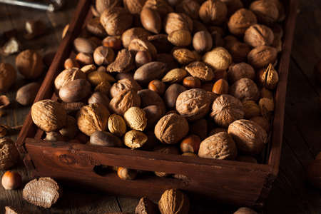 almond: Assorted Mixed Organic Nuts with Walnuts Almonds and Pecans Stock Photo