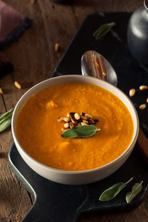 carrot: Homemade Carrot Ginger Soup with Toasted Pine Nuts