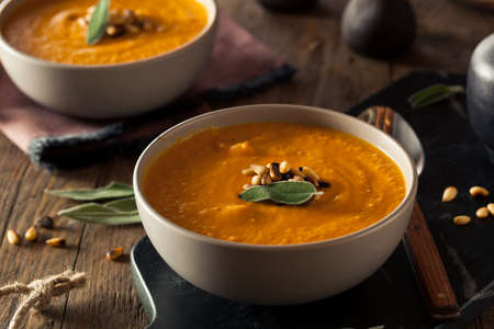 Homemade Carrot Ginger Soup with Toasted Pine Nuts