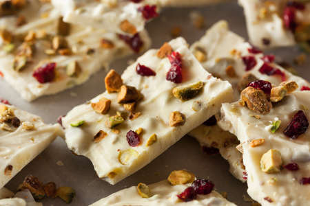 white bars: Festive White Chocolate Holiday Bark with Cranberry and Pistachio Stock Photo
