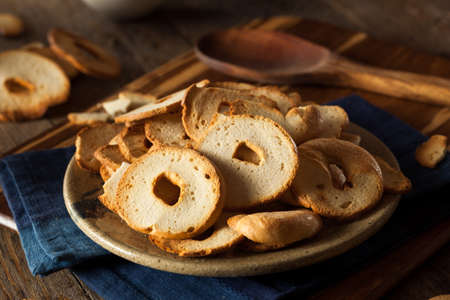 ovenbaked: Homemade Whole Wheat Bagel Chips on a Plate Stock Photo