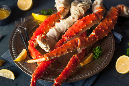 crab meat: Cooked Organic Alaskan King Crab Legs with Butter