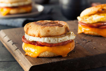 english breakfast: Homemade Breakfast Egg Sandwich with Cheese on an English Muffin
