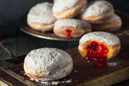 Homemade Sugary Paczki Donut with Cherry Filling Banco de Imagens - 51624817