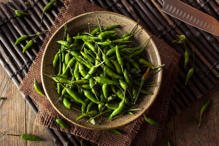 thai chili pepper: Hot Green Thai Chili Pepper in a Bowl