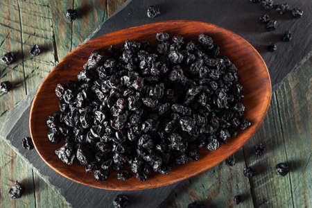 blueberries: Healthy Raw Dried Blueberries in a Bowl Stock Photo