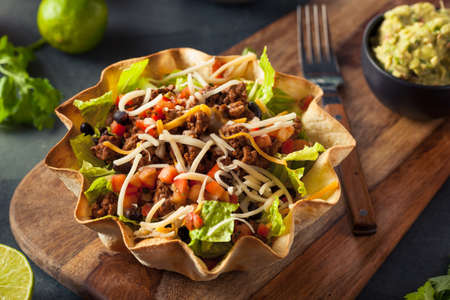 taco: Taco Salad in a Tortilla Bowl with Beef Cheese and Lettuce