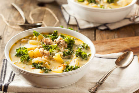 Homemade Warm Creamy Tuscan Soup with Sausage and Kale Stock Photo