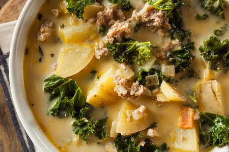 tuscana: Homemade Warm Creamy Tuscan Soup with Sausage and Kale Stock Photo