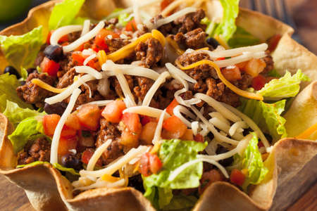 taco tortilla: Taco Salad in a Tortilla Bowl with Beef Cheese and Lettuce