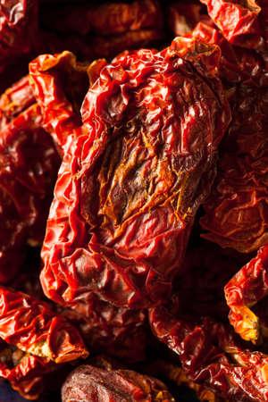 sun dried: Organic Raw Sun Dried Tomatoes in a Bowl Stock Photo