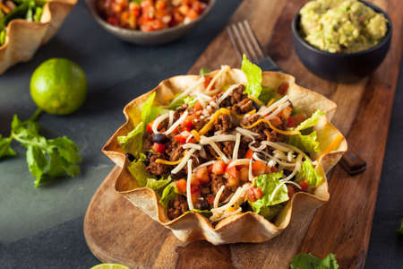 mexican black: Taco Salad in a Tortilla Bowl with Beef Cheese and Lettuce