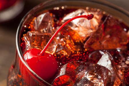 garnish: Sweet Refreshing Cherry Cola with Garnish and Straw