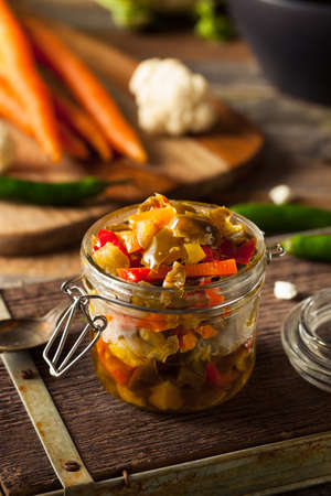 preserving: Spicy Homemade Pickled Giardiniera with Peppers, Carrots and Cauliflower