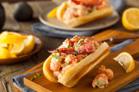 lobster dinner: Homemade New England Lobster Roll with Lemons Stock Photo