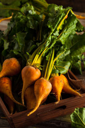 beets: Raw Organic Golden Beets in a Box Stock Photo