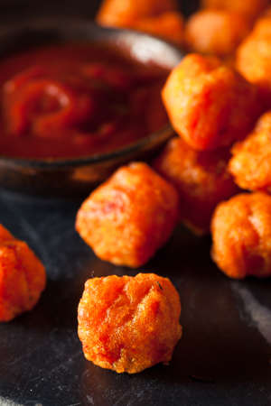 tots: Homemade Sweet Potato Tater Tots with Ketchup Stock Photo