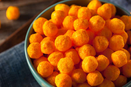Unhealthy Cheesy Cheese Puffs in a Bowl