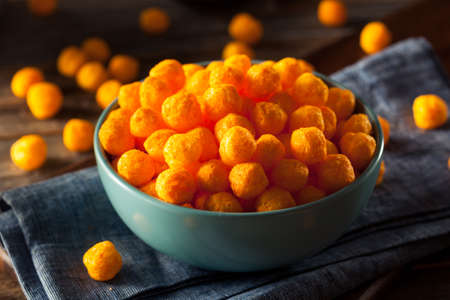 Unhealthy Cheesy Cheese Puffs in a Bowl