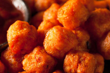 person appetizer: Homemade Sweet Potato Tater Tots with Ketchup Stock Photo