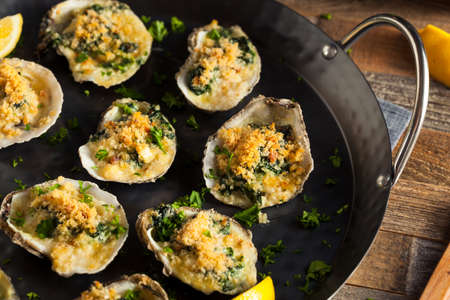 prepared shellfish: Homemade Creamy Oysters Rockefeller with Cheese and Spinach