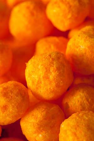 puffs: Unhealthy Cheesy Cheese Puffs in a Bowl