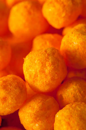 cheesy: Unhealthy Cheesy Cheese Puffs in a Bowl