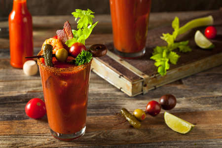 Homemade Bacon Spicy Vodka Bloody Mary with Tomatos, Olive and Celery Imagens - 53864681