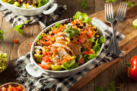 corn salad: Homemade Mexican Chicken Burrito Bowl with Rice and Beans