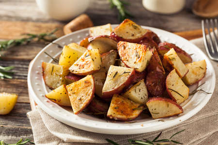 baked potatoes: Homemade Roasted Herb Red Potatoes with Salt and Pepper