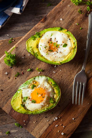 baked: Homemade Organic Egg Baked in Avocado with Salt and Pepper