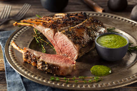 Homemade Herb Roast Lamb with Green Sauce Stock Photo