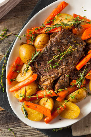 slow cooker: Homemade Slow Cooker Pot Roast with Carrots and Potatoes Stock Photo