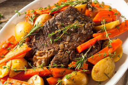 red onions: Homemade Slow Cooker Pot Roast with Carrots and Potatoes Stock Photo