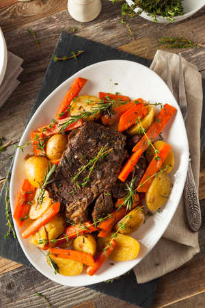slow: Homemade Slow Cooker Pot Roast with Carrots and Potatoes Stock Photo