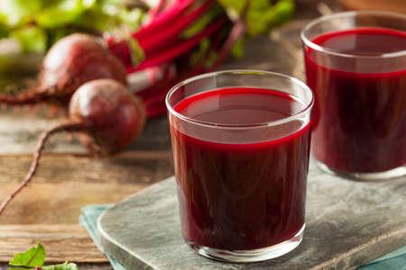 beet juice: Raw Organic Beet Juice in a Glass Stock Photo