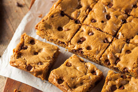 blondy: Homemade Chocolate Chip Blondies Cut Into Squares
