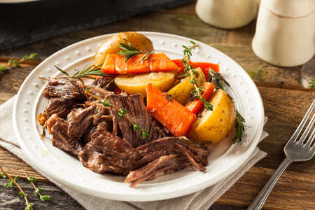 Homemade Slow Cooker Pot Roast with Carrots and Potatoes Stock Photo
