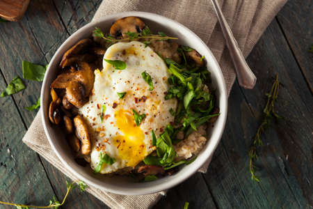 Healthy Homemade Savory Oatmeal with Eggs Mushrooms and Spinach