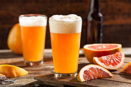 beer foam: Sour Grapefruit Craft Beer Ready to Drink Stock Photo