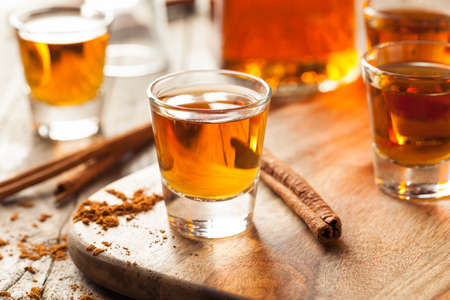alcoholic drinks: Cinnamon Whiskey Bourbon in a Shot Glass Ready to Drink Stock Photo