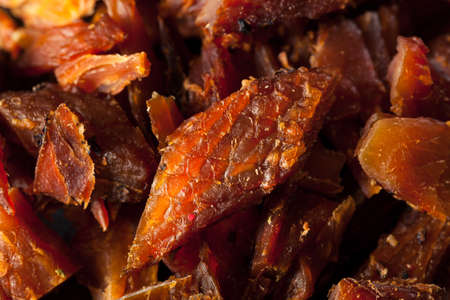 salted: Dried Smoked Salmon Jerky with Salt and Pepper Stock Photo
