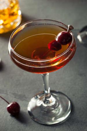 bourbon: Homemade Rye Bourbon Manhattan with a Cherry Garnish Stock Photo