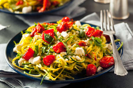Homemade Zucchini Noodles Zoodles Pasta with Tomatos and Feta Stock Photo